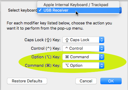 System Preferences / Keyboard / Modifier Keys - with USB Receiver clicked and Option swapped for command, and Command swapped for Option